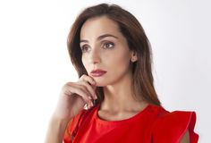 Woman thinking. Expression with chin on hand Stock Image