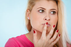 Woman thinking face expression with finger close to lips Royalty Free Stock Image