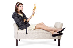 Woman Thinking with a Figurine Royalty Free Stock Photography