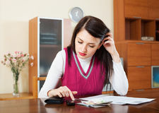 Woman thinking about the financial issue Stock Photo