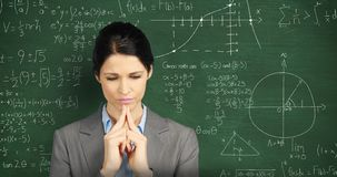 Woman thinking in front of chalkboard with moving math calculations
