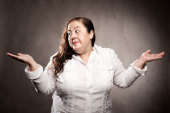 Woman thinking on a gray background Stock Photography