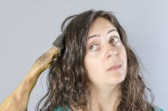 Woman thinking with ham leg in her head. Stupid situation Stock Photo