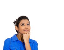 Woman thinking hand on cheek looking up having an idea Stock Images