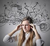 Woman thinking really hard Royalty Free Stock Photography