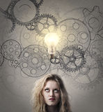 Woman thinking hard. With wheel gears in the beckground Royalty Free Stock Images