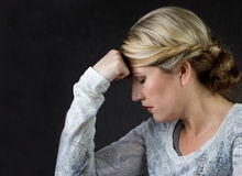 A woman thinking or with a headache Royalty Free Stock Photos