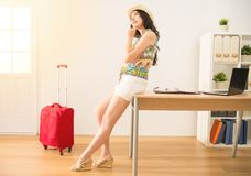 Woman thinking her daydream holiday. Successful business woman thinking about her daydream holiday for trip plan ready to go. mixed race asian chinese model Royalty Free Stock Images
