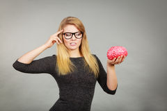 Woman thinking and holding fake brain Stock Photography