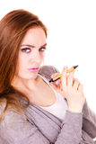 Woman thinking holds pen Stock Image