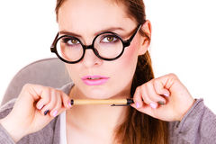Woman thinking holds pen Stock Images