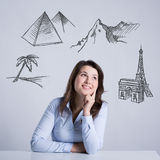 Woman thinking about holidays Stock Photography