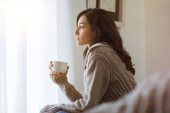 Woman thinking at home Royalty Free Stock Photography