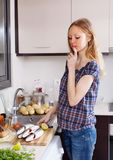 Woman  thinking how to cook fish Royalty Free Stock Photo