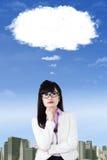 Woman thinking idea under cloud Stock Photos