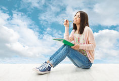 Woman thinking inspiration, write idea, Artist Creativyty. Young woman, girl teenager thinking inspiration or write idea, sitting over blue sky background stock images