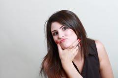 Woman thinking ironic Royalty Free Stock Photo