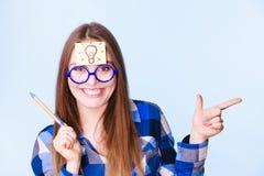 Woman thinking light idea bulb on head, creative girl lots of ideas Royalty Free Stock Image