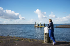 Woman thinking and looking at sea Royalty Free Stock Image
