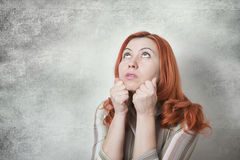 Woman thinking and looking up Stock Image