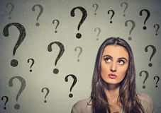 Woman thinking looking up has many questions Stock Image