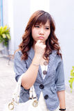 Woman thinking in mall Royalty Free Stock Photo