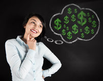 Woman thinking about Money Stock Image