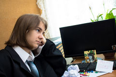 Woman thinking in office Stock Images