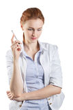 Woman thinking with a pen Royalty Free Stock Images