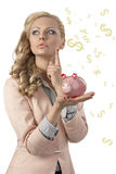 Woman thinking with piggybank. Pretty blonde woman with business suit and curly hair-style thinking and taking in the hand one pink piggybank Stock Images