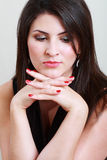 Woman thinking. Portrait of thinking and sad woman over light grey background Stock Image
