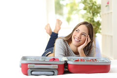 Woman thinking and preparing a travel Stock Photography