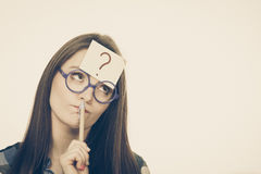 Woman thinking question mark on her head Royalty Free Stock Photo