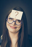 Woman thinking question mark on her head Stock Image