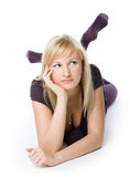 Woman thinking in a relaxed pose Stock Image
