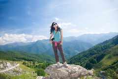 Woman thinking on rock in Cantabrian mountain Royalty Free Stock Photo
