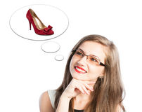 Woman thinking at shoes Royalty Free Stock Photos