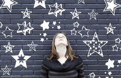 Woman thinking stars Royalty Free Stock Images
