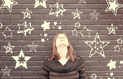 Woman thinking stars Royalty Free Stock Image