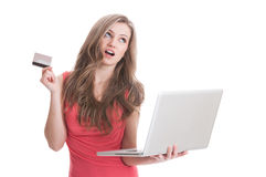 Woman thinking to buy online using credit or debit card Stock Photography