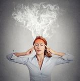 Woman thinking too hard steam coming out up of head Royalty Free Stock Photo