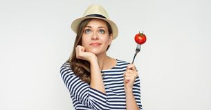 Woman thinking about vegetable diet. Isolated portrait Royalty Free Stock Photography