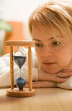 Woman thinking and waiting royalty free stock photos