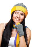 Woman thinking wearing cap Royalty Free Stock Images