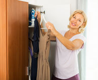 Woman thinking what get dressed Royalty Free Stock Photo