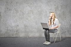 Woman thinking what writing Royalty Free Stock Image