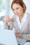 Woman thinking while working at her desk Royalty Free Stock Images