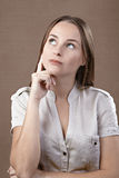 Woman thinking Stock Photography