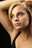 Woman thinks. A young beautiful woman with blond hair Royalty Free Stock Photos