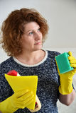 Woman thinks about the upcoming cleaning in  house Royalty Free Stock Image